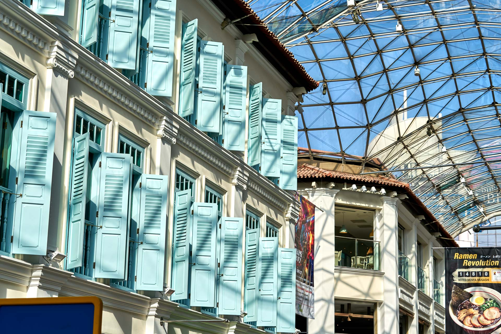 architectural photography showing restored shop houses and restaurant at bugis junction mall in singapore
