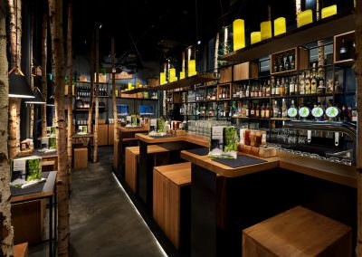 Interior photography of Hans Im Gluck Restaurant in Singapore at dusk with bar