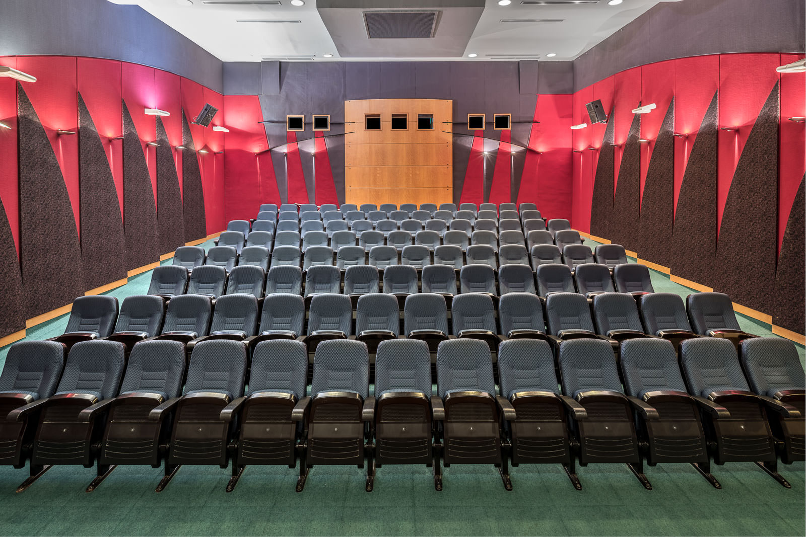 Interior photography of the seletar country club in singapore showing a straight angle of the auditorium