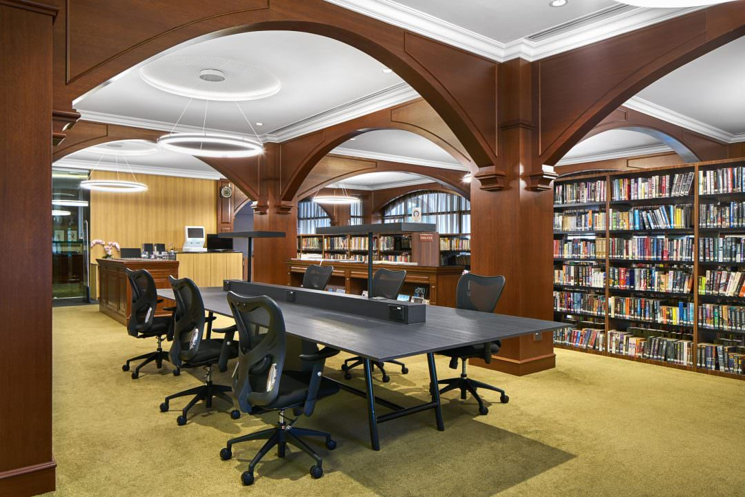 interior photography of a library showing study desks at tanglin club in singapore